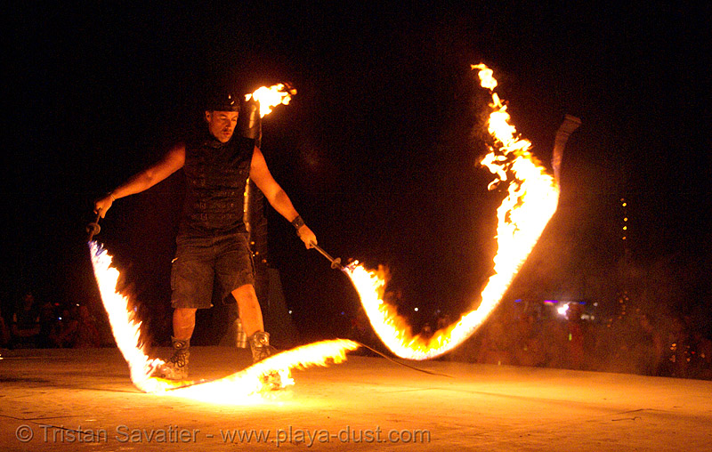 zenferno with fire whips - fire performer on the shiva vista stage - burning man 2007, burning man, fire whips, flames, michael dragonfly, night, shiva vista stage, zenferno