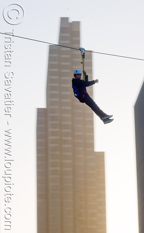 zip-line over san francisco, adventure, buildings, cable line, cables, climbing helmet, embarcadero, extreme sport, gear, hanging, harness, high-rise, justin herman plaza, mountaineering, moving fast, speed, steel cable, tower, trolley, tyrolienne, urban, zip line, zip wire, ziptrek