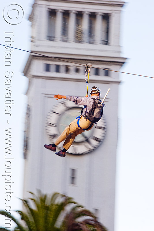 zip-line over san francisco, adventure, blue sky, cable line, cables, campanil, climbing helmet, clock, clock tower, embarcadero, embarcadero tower, extreme sport, fast, ferry building, gear, hanging, harness, justin herman plaza, mountaineering, moving, moving fast, people, speed, steel cable, trolley, tyrolienne, urban, zip line, zip wire, ziptrek