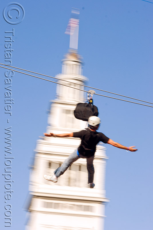 zip-line over san francisco, adventure, blue sky, cable line, cables, campanil, climbing helmet, clock tower, embarcadero tower, ferry building, hanging, mountaineering, moving fast, speed, steel cable, trolley, tyrolienne, urban, zip line, zip wire