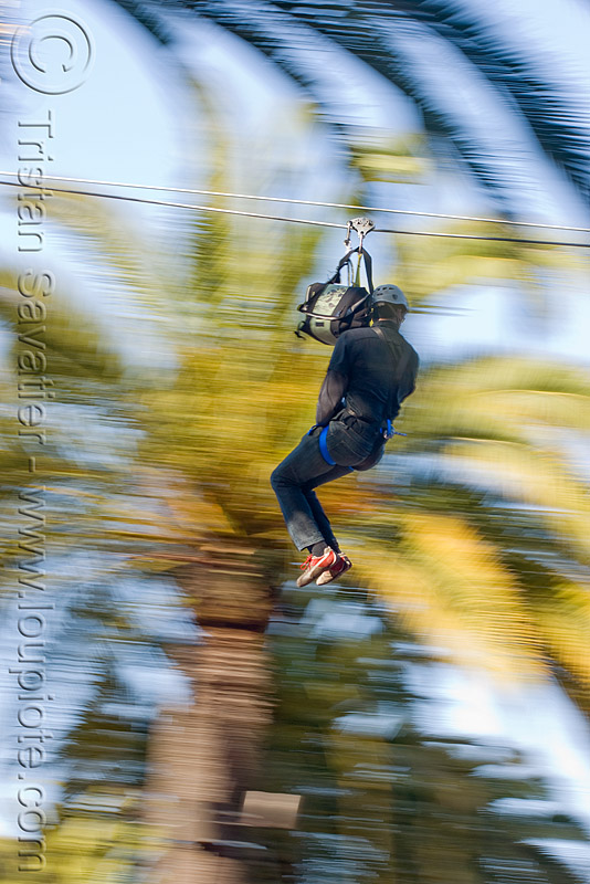 zip-line over san francisco, adventure, blue sky, cable line, cables, climbing helmet, embarcadero, extreme sport, fast, gear, hanging, harness, justin herman plaza, mountaineering, moving, moving fast, palm trees, people, speed, steel cable, trolley, tyrolienne, urban, zip line, zip wire, ziptrek