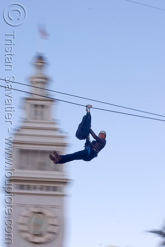 zip-line over san francisco, adventure, blue sky, cable line, cables, campanil, climbing helmet, clock tower, embarcadero, embarcadero tower, extreme sport, fast, ferry building, gear, hanging, harness, justin herman plaza, mountaineering, moving, moving fast, people, speed, steel cable, trolley, tyrolienne, urban, zip line, zip wire, ziptrek