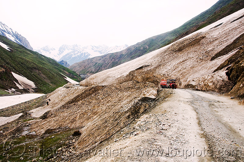 zojila pass - truck - old snow - drass valley - leh to srinagar road - kashmir, dras valley, drass valley, india, kashmir, mountains, zoji la, zoji pass, zojila pass