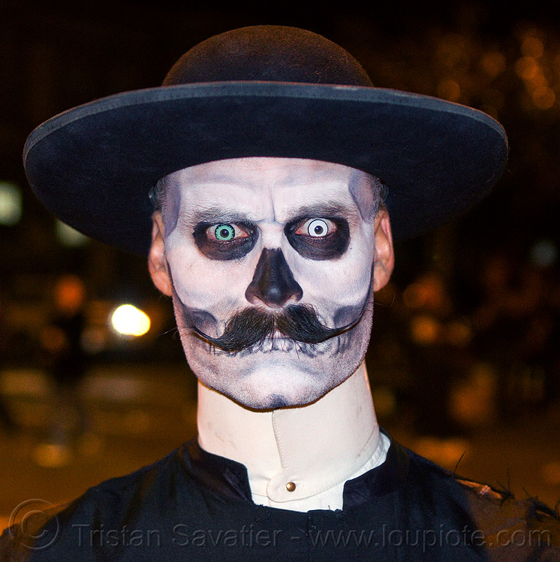 zombie priest with scary eyes, black hat, blue contact lenses, blue lenses, cappello romano, cassock, clergy, clerical collar, color contact lenses, day of the dead, dia de los muertos, face painting, facepaint, halloween, man, mustache, night, pastor, priest, randal smith, saturno hat, skull makeup, special effects contact lenses, theatrical contact lenses, white contact lenses, white contacts, zombie