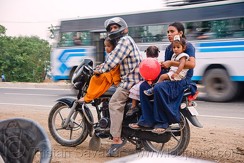 A family of five on a motorbike (india), children, couple, family, five, kids, man, motorbike touring, motorcycle touring, rider, riding, road, underbone motorcycle, woman