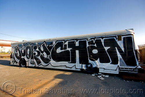 abandoned SFPD police bus with graffiti (san francisco), autobus, goory chan, gory chan, graffiti, junkyard, no trespassing, san francisco police department, sfpd bus, street art