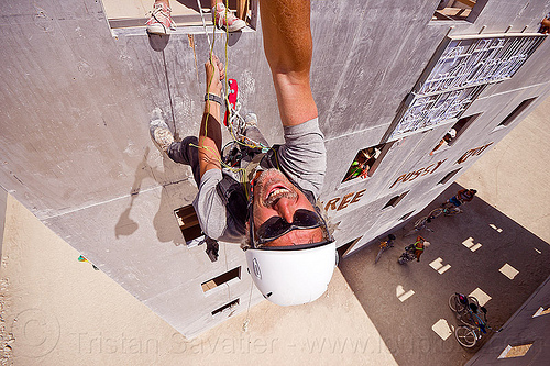 abseiling wall street building - burning man 2012, abseiling, buildings, burning man, climbing harness, climbing helmet, descender, descendeur, goldman sucks, mountaineering helmet, petzl, rappelling, rock climbing, selfie, selfportrait, single rope, static rope, vertical, wall street