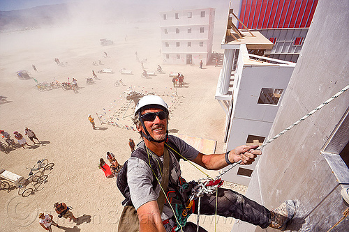 abseiling wall street - burning man 2012, abseiling, buildings, burning man, climbing harness, climbing helmet, descender, descendeur, dust storm, haboob, mountaineering helmet, petzl, rappelling, rock climbing, selfie, selfportrait, single rope, static rope, vertical, wall street, white out