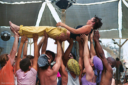 acro-yoga at center camp - burning-man 2003, acro-yoga, burning man, center camp, crowd, held up, holding up, lying down, people, rian, ryan, woman