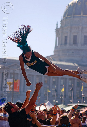 acrobatics - cheer leaders, acrobatics, cheer leaders, civic center, crowd, gay pride festival, woman