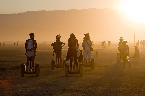 all terrain segways, backlight, burning man, haze, hazy, segway x2, segways, shadows, silhouettes