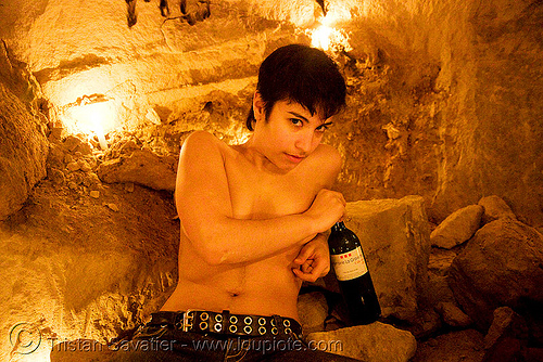 alyssa - catacombes de paris - catacombs of paris (off-limit area), alyssa, androgynous, bottle, candles, catacombs of paris, cataphile, cave, new year's eve 2008, underground quarry, wine, woman