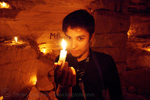 alyssa - catacombes de paris - catacombs of paris (off-limit area) - candles, androgynous, cataphile, cave, fire, flames, new year's eve, new year's eve 2008, people, the devil, underground quarry, wax, woman