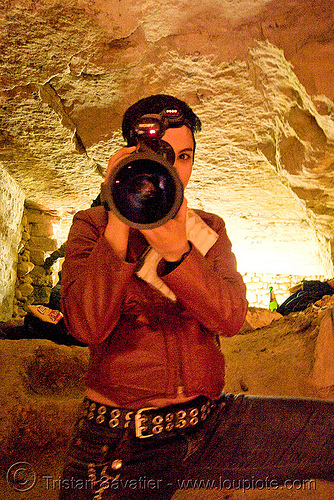 alyssa with video camera - catacombes de paris - catacombs of paris (off-limit area), alyssa, androgynous, camcorder, candles, catacombs of paris, cataphile, cave, clandestines, illegal, new year's eve 2008, shooting, underground quarry, video camera, woman