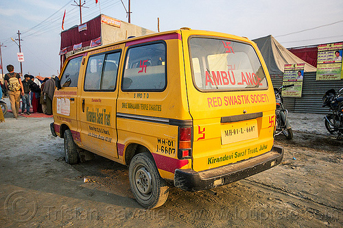 ambulance of the red swastik society (india), ambulance, car, hindu pilgrimage, hinduism, india, maha kumbh mela, medics, minibus, paramedics, red swastik society, swastika, van, yellow