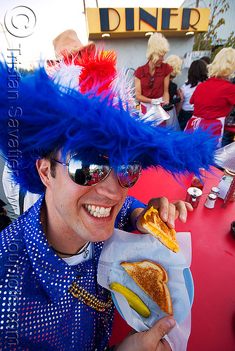 american customer eating grill-cheese sandwitch at the dust-city diner - burning man decompression 2008 (san francisco), american, blue, burning man decompression, customer, dust-city diner, eating, fluffy, grilled-cheese, hat, red, sandwitch, sunglasses, white