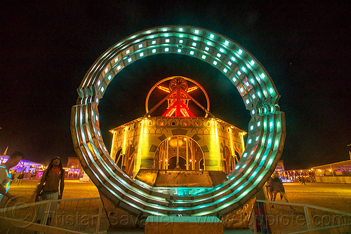 animated steel rings sculpture - burning man 2016, animated, art installation, burning man, disc-go-sphere, glowing, led light, night, rings, sculpture, the man