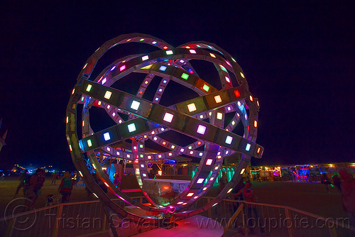 animated steel rings sculpture with LED lights - burning man 2016, animated, art installation, burning man, disc-go-sphere, glowing, led light, night, sculpture, the man