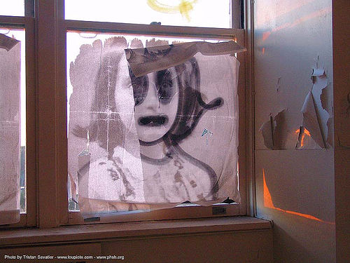 anne frank poster in window, abandoned building, abandoned hospital, ann frank, anne frank, decay, desecrated, desecration, graffiti, presidio hospital, presidio landmark apartments, salt, trespassing, urban exploration, vandalized, window