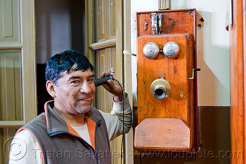 old telephone, calling, dynamo, hand crank, man, noroeste argentino, old, railroad, railway, san antonio de los cobres, telephone, train station, tren a las nubes, wall phone