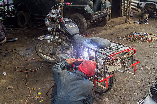 arc welding repair on bullet motorbike rack (india), 350cc, arc welding, fixing, luggage rack, man, mechanic, motorcycle, repairing, royal enfield bullet, sikkim, thunderbird, welder, worker, working