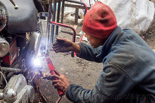 arc welding repair on motorbike rack (india), 350cc, arc welding, fixing, luggage rack, man, mechanic, motorcycle, repairing, royal enfield bullet, sikkim, sparks, thunderbird, welder, worker, working