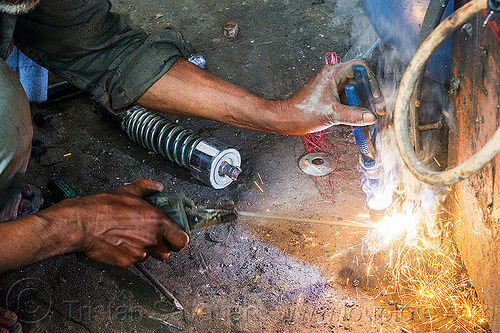 arc welding repair on motorbike shock (india), 350cc, arc welding, fixing, man, mechanic, motorbike, motorcycle, repairing, royal enfield bullet, shock absorber, sikkim, sparks, thunderbird, welder, worker, working