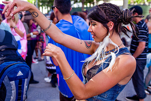 ariana, ariana, blue stones necklace, dancing, how weird festival, white feather earrings, woman