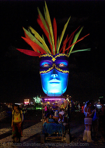 art car with big blue masked faces - burning man 2007, art car, blue face, burning man, mark sheets, mask, night