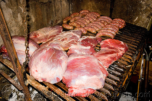 asado - meat and chorizo barbecue, asado, barbecue, bbq, chorizo, grill, hostel clan, noroeste argentino, raw meat, sausages