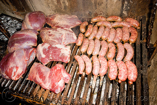 asado - meat and chorizo BBQ, argentina, asado, barbecue, bbq, chorizo, grill, hostel clan, noroeste argentino, raw meat, sausages