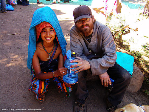 asha-with-guy - rainbow gathering - hippie, asha, couple, hippie, man, rainbow family, rainbow gathering, sitting, woman