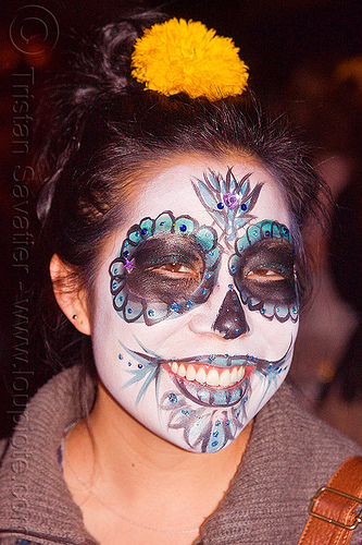 asian woman with sugar skull makeup, asian woman, bindis, day of the dead, dia de los muertos, face painting, facepaint, halloween, joy, night, sugar skull makeup, yellow flower headdress