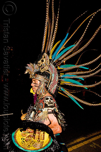 aztec dancer with feathers - dia de los muertos - halloween (san francisco), aztec, costume, day of the dead, dia de los muertos, face painting, facepaint, feathers, halloween, makeup, man, mexican, night