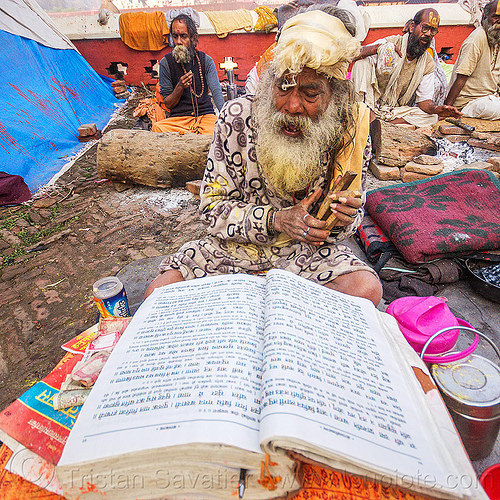 baba (hindu devotee) reading mantras from big book (nepal), baba, book, festival, hindu, hinduism, kathmandu, maha shivaratri, man, mantras, pashupati, pashupatinath, praying, reading, sadhu, white beard