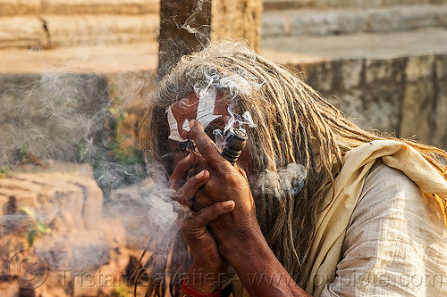 baba smoking a chillum of weed - ritual cannabis (nepal), baba, chillum, dreadlocks, ganja, hindu, hinduism, kathmandu, maha shivaratri, man, pashupatinath, sadhu, smoke, smoking, tilak, weed