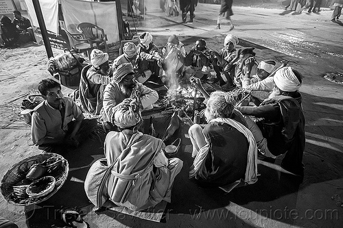 babas sitting in circle around campfire - kumbh mela (india), babas, campfire, circle, fire, hindu, hinduism, kumbha mela, maha kumbh mela, night, sadhu, sitting, smoke, street