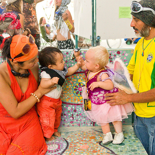 babies playing - burning man 2013, babies, boy, burning man, chid, children, father, kids, mother, toddlers, woman