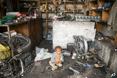 baby in motorcycle mechanic shop - keylong - manali to leh road (india), baby, child, girl, kid, motorbike touring, motorcycle mechanic, motorcycle touring, road, shop, toddler, workshop