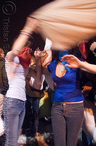bandana girl swinging a pillow - the great san francisco pillow fight 2009 - olivia, bandana, down feathers, girls, night, olivia, pillow fight club, pillows, women, world pillow fight day