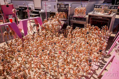 barbie dolls pushed into gas ovens - barbie death camp - burning man 2015, barbie death camp, barbie dolls, burning man, ovens