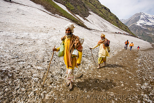bare-feet sadhus (hindu holy men) on glacier trail - amarnath yatra (pilgrimage) - kashmir, amarnath yatra, babas, bare feet, barefoot, glacier, hiking canes, hindu holy men, hindu pilgrimage, hinduism, india, kashmir, man, mountain trail, mountains, pilgrims, sadhus, snow, trekking, walking sticks