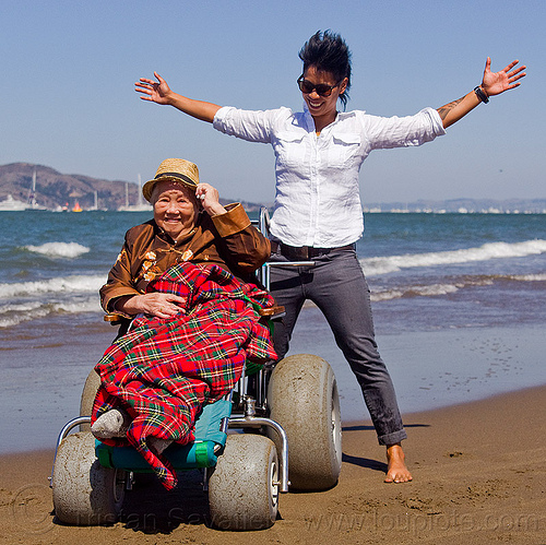 beach wheelchair - grandma and granddaughter, beach wheelchair, blanket, chinese, crissy field beach, family, grandma, grandmother, happy, jenn, ocean, old woman, sand, sea, senior, straw hat, water, women