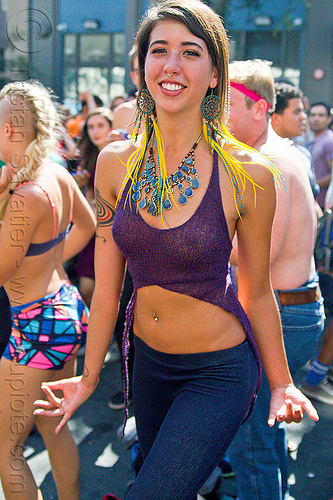 beautiful young woman - ariana, ariana, belly piercing, bellybutton piercing, blue stone necklace, dancing, feather earrings, gay pride festival, navel piercing, nose piercing, septum piercing, woman, yellow feathers