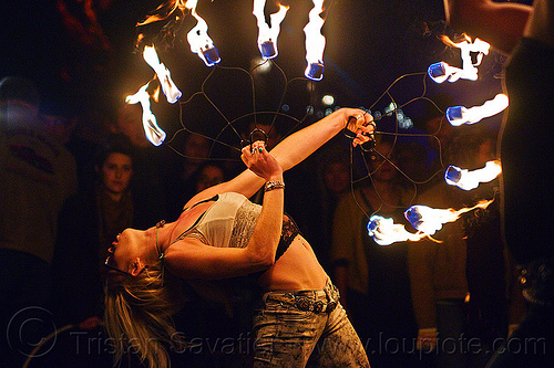 bending backward with fire fans, american steel studios, bending backward, cressie mae, fire dancer, fire dancing, fire fans, fire performer, fire spinning, flames, holidays in flux, night, oakland, poplar gallery, spinning fire, woman