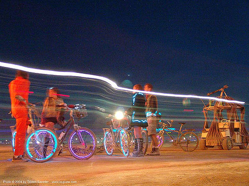 bicycles decorated with EL-wire - burning man 2004, bicycles, bikes, burning man, el-wire, electroluminescent wire, night