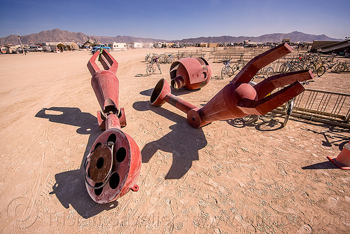 big red robot dismembered - becoming human - burning man 2015, arms, art installation, becoming human, burning man, center camp, christian ristow, disassembled, dismembered, giant, head, metal, parts, red, robot, sculpture, statue, steel