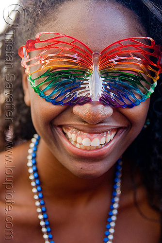 black girl with rainbow carnival mask, black woman, carnival mask, gay pride festival, rainbow colors