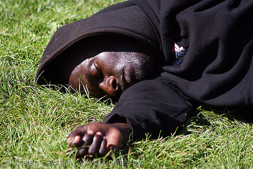black man sleeping on grass, african american man, black man, grass, hand, hood, hooded, lawn, lying down, sleeping
