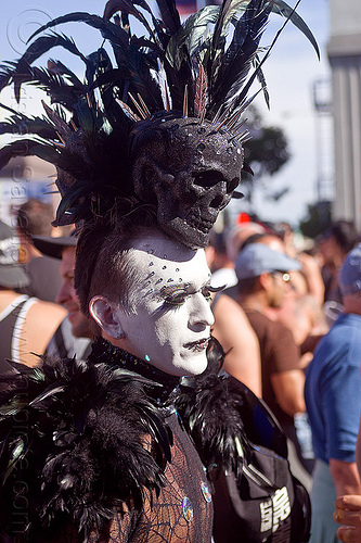 black skull headdress, bindis, black feathers, black skull, costume, eyelashes extensions, feather headdress, folsom street fair, man, spikes, spiky, white facepaint, white makeup